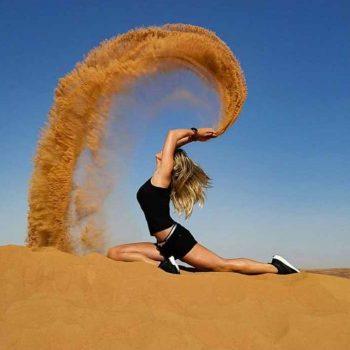 girl posing with sand