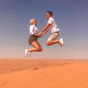 couple jump during dune bashing