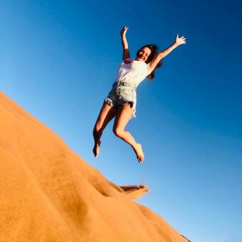 girl jump in desert